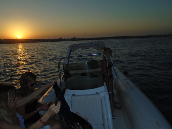 private speedboat by sunset time